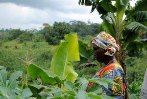 female cacao farmer in between trees femmes de virunga congo